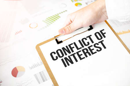 Text REFuND on white paper plate in businessman hands with financial diagram. Business concept