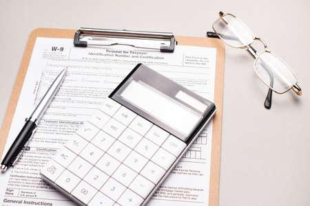 A Tax Form, Pen and Calculator. Finance concept Stock fotó