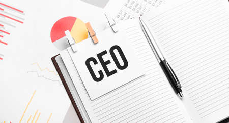 text CEO on stickers on the diary with office tools