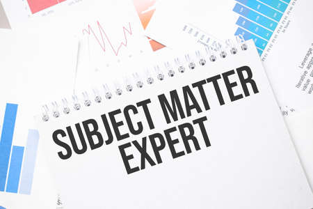 SUBJECT MATTER EXPERT text on paper on the chart background with pen