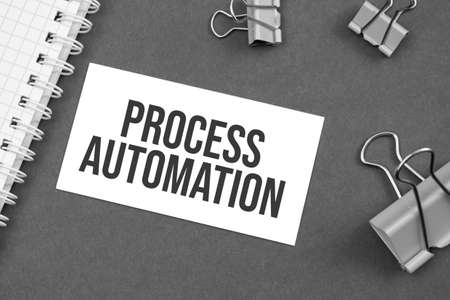 The word Process Automation word written on gray background with paper clips. word Stok Fotoğraf