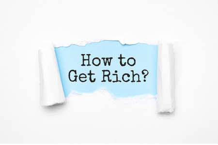 Concept of discovering how to get rich tricks. Uncovered unrolled beige torn paper and search engine optimization abbreviation.