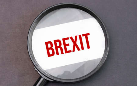 Brexit word on paper through magnifying lens. Stok Fotoğraf