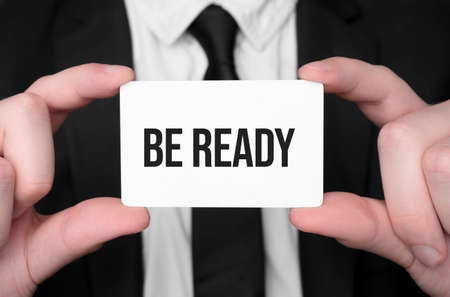 Businessman holding a card with text be ready Stok Fotoğraf