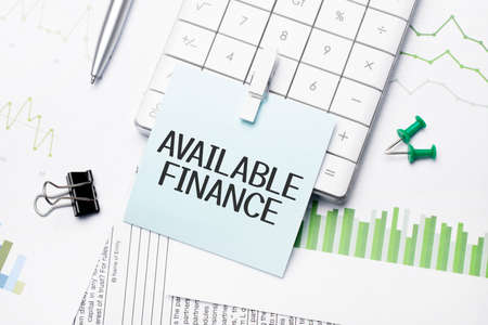 text available finance. Written words on paper notebook. workplace. Business concept.