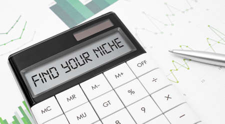 calculator with the word FIND YOUR NICHE on display with chart