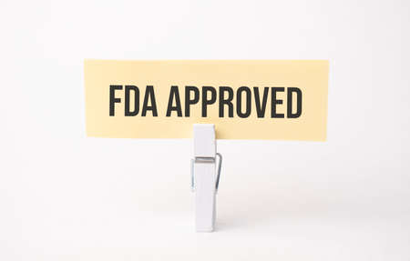 fda approved text on paper. On white background