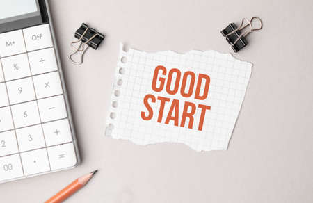 Business concept. Notebook with text good start sheet of white paper for notes, calculator, glasses, pencil, pen, in the white background Stok Fotoğraf