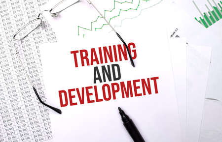 Training and Development. Conceptual background with chart, papers, pen and glasses