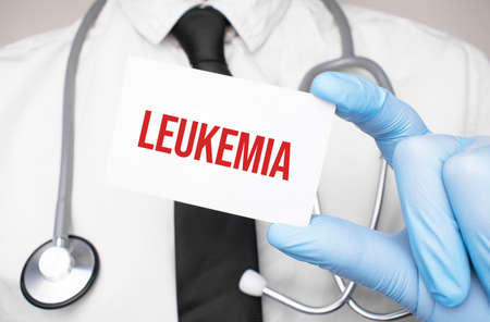Doctor holding a card with leukemia, Medical concept