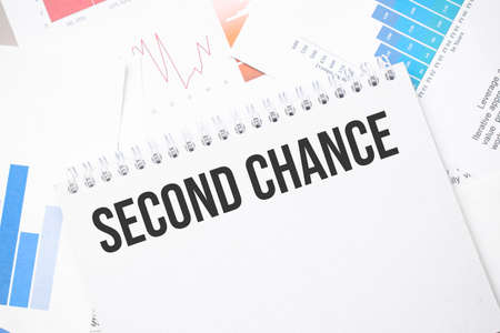 second chance text on paper on the chart background with pen
