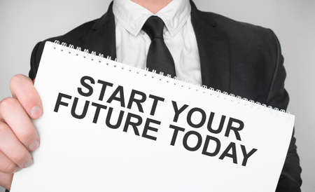 Businessman holding a card with text start your future today