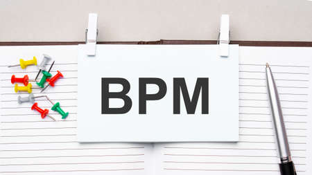 text bpm on stickers on the diary with office tools