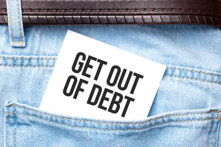 get out of debt words on a white paper stuck out from jeans pocket. Business concept. Stockfoto