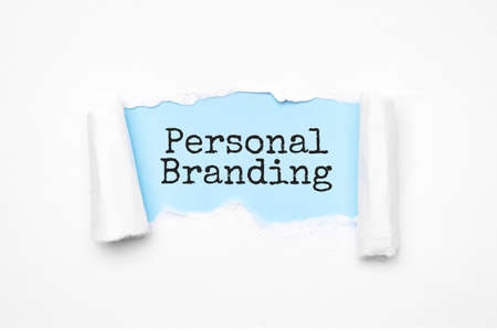 Concept of discovering Personal Branding. Uncovered unrolled beige torn paper and search engine optimization abbreviation.