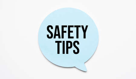 Safety tips speech bubble and black magnifier isolated on the yellow background.