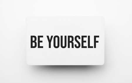 Be yourself sign on notepad on the white backgound