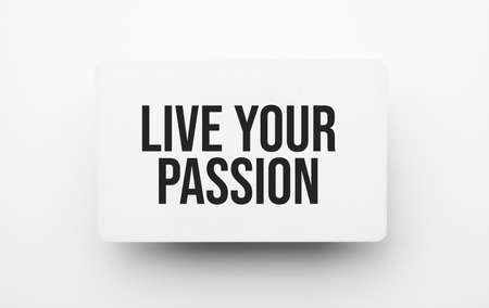 LIVE YOUR PASSION sign on notepad on the white backgound