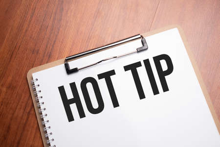 Hot tip text on white paper on the wood table