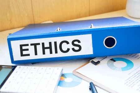 ethics words on labels with document binders