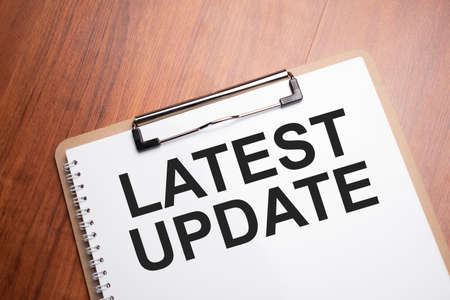 latest update text on white paper on the wood table