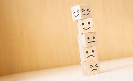 Wooden blocks with the happy face smile face symbol symbol on the table, evaluation, Increase rating,