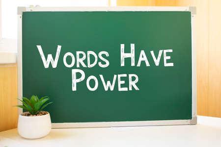 words have power inscription in chalk on the school board, Search engine optimization and websites. Desk, swept balls of paper, computer keyboard