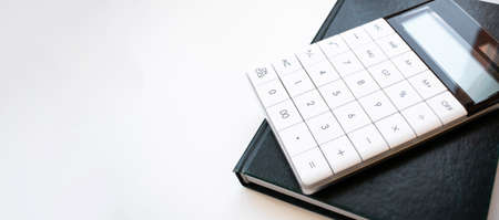 calculater, pen and blank notebook for office on white background isolated