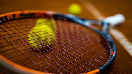 Tennis racquet with a ball under it 写真素材