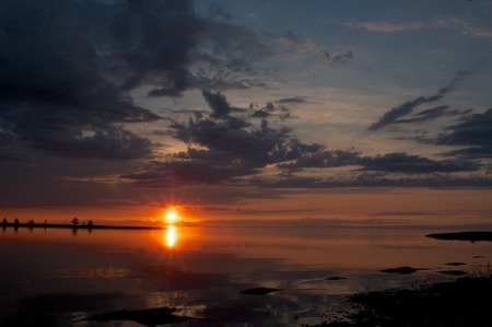 shamanism: the sunset at Lake Baikal in summer time