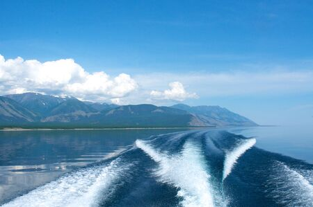 crone: waves from a boat on Lake Baikal with mountain background, Russia