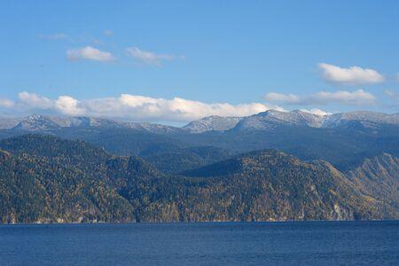Beautiful mountain lake and distant mountains. Teletskoye in the Altai mountain lake Stock Photo