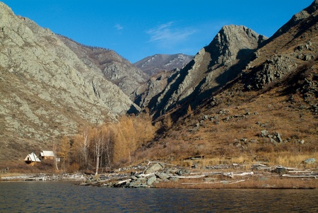 scrambling: Autumn lake and blue sky in the Sayan mountains