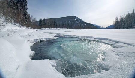 Unfrozen mountain river with blue water, Russia Stock Photo