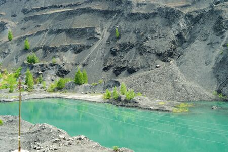 Abandoned and flooded quarry for coal mining in the Kemerovo region Stock Photo