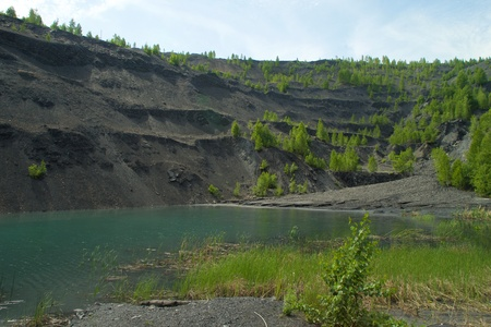 sand quarry: Abandoned and flooded quarry for coal mining in the Kemerovo region Stock Photo