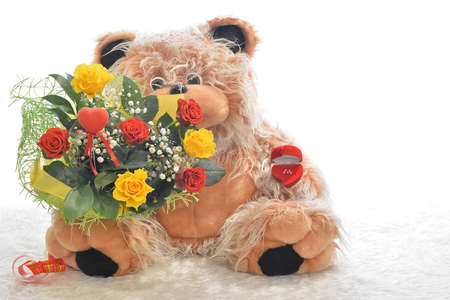 Teddy bear with a bouquet of flowers photo