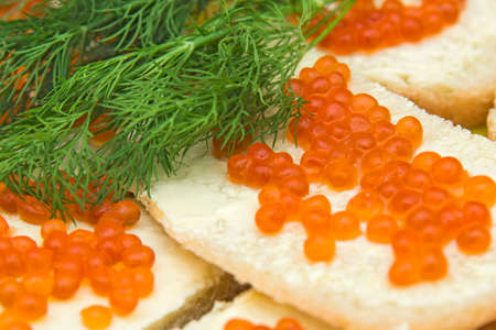 sandwich with red caviar and greens photo