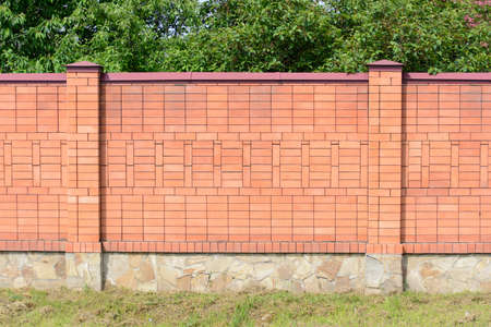 high fence of red brick Archivio Fotografico