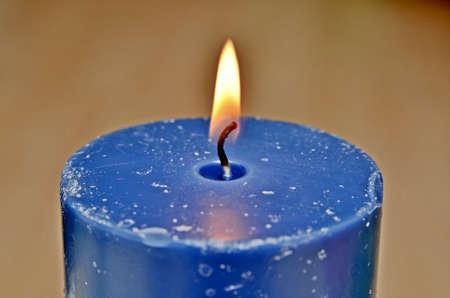 lit candle illuminates the space photo