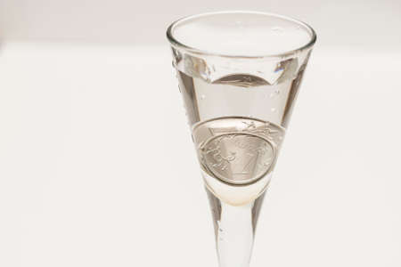 the Russian rubles are on the bottom of the glass photo