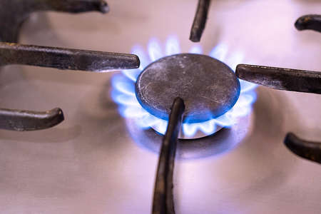 combust: burning gas from the gas burner plate