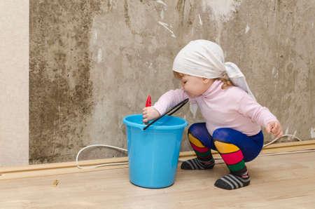 baby 4 5 years: child helps to make repairs