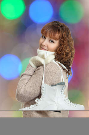 skating on thin ice: Girl with skates over her shoulder Stock Photo