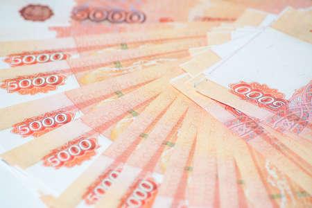 monies: five-thousandth banknotes lie fan