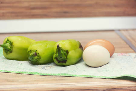 medium group of objects: bell pepper and eggs in their shells