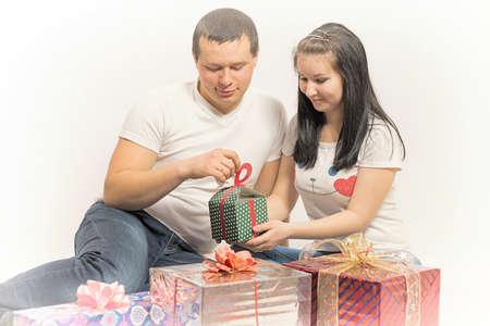20 29: woman man opens presents