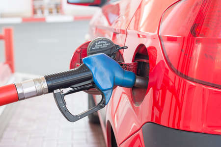 refueling: refueling the car with fuel at a gas station Stock Photo