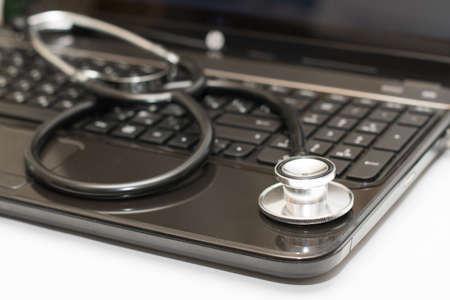 health insurance: stethoscope lying on computer keyboard Stock Photo