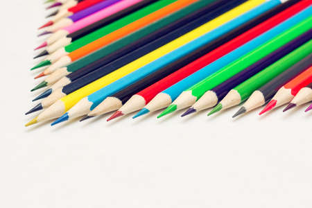 lined up: colored pencils lined up in rows